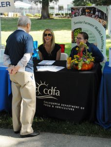 Monica Pedigo (right) and Crystal Myers with CDFA's Office of Grants Administration helped seniors make the connection between nutrition and farmers' markets.