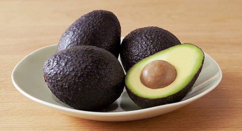 Photo of four avocados.