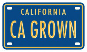 "Iconic blue California license plate with the letters ""CA GROWN"""