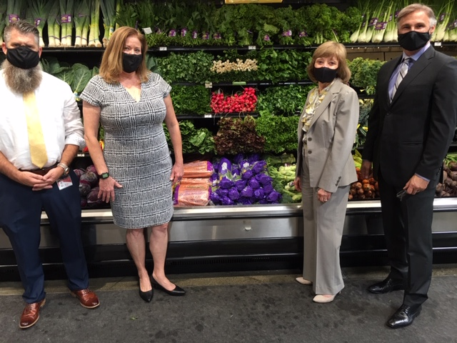 Four people standing in front of a colorful produce display at Raley's supermarket in the Sacramento area of California. Pictured from left: Raley's Director of Produce Michael Schutt, CA Grown Executive Director Sher Watte Angulo; CDFA Secretary Karen Ross; and Raley's President and CEO Keith Knopf. All are wearing masks (COVID).